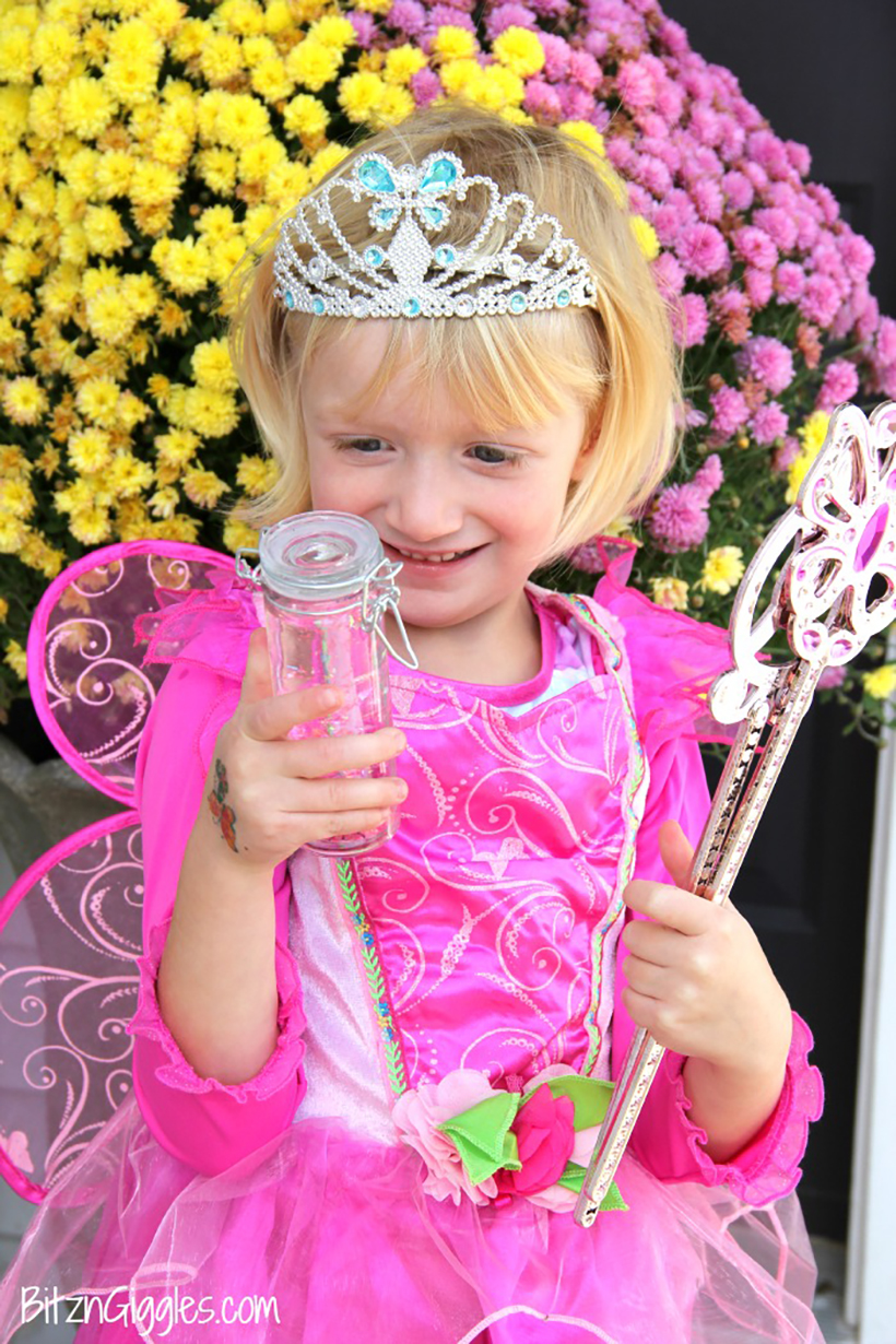 happy princess with magical glowing fairy bottle