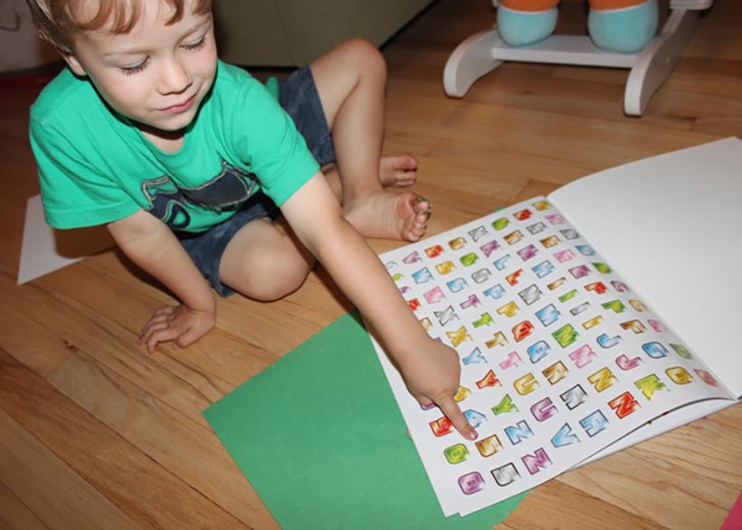boy and sticker book