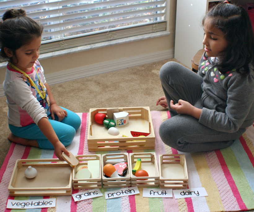 teach your child about food groups girls playing on floor