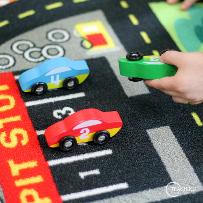 toddler race car counting holding car 3