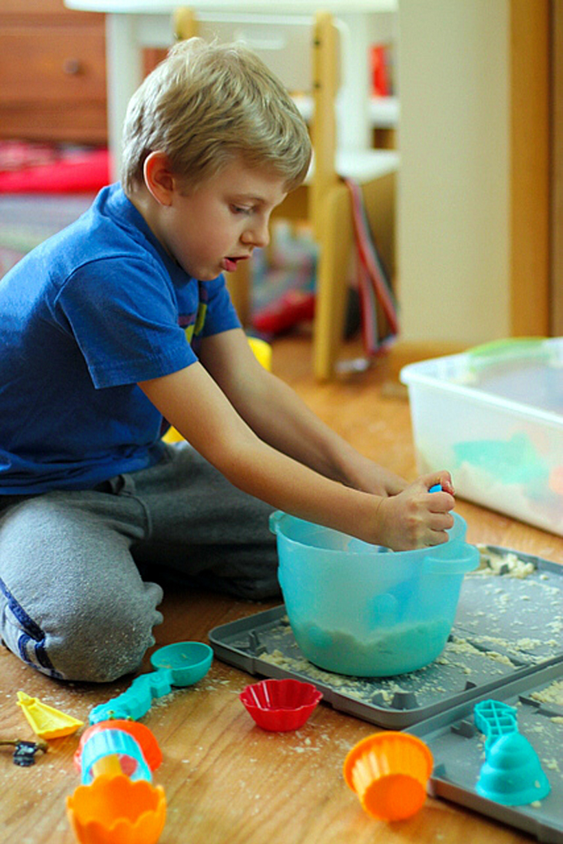 Boy Playing with Bowl