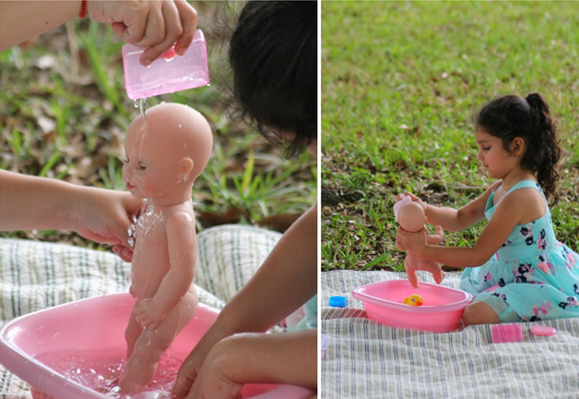 Sibling Water Play with Baby