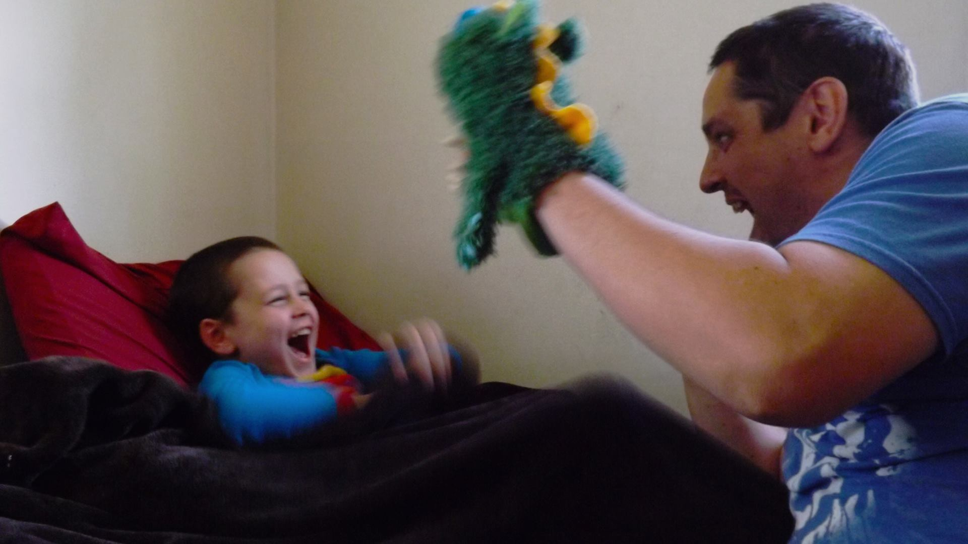 Dad Blogger Chris does puppet storytime. They create imaginative scenarios together - adventures that the puppet goes on. This is a great way to use pretend play to spark imagination!