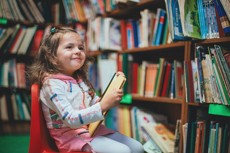 Girl reading at the library