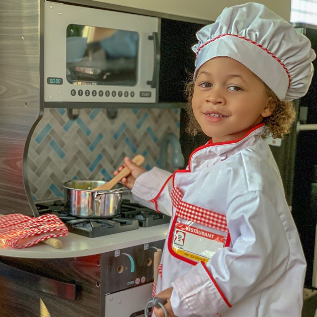 kid in chef costume
