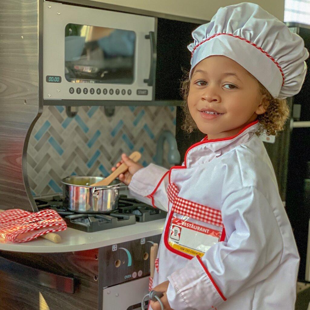 kid in chef costume