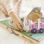 Melissa & Doug Take-Along Kingdom wooden train toy closeup of signature