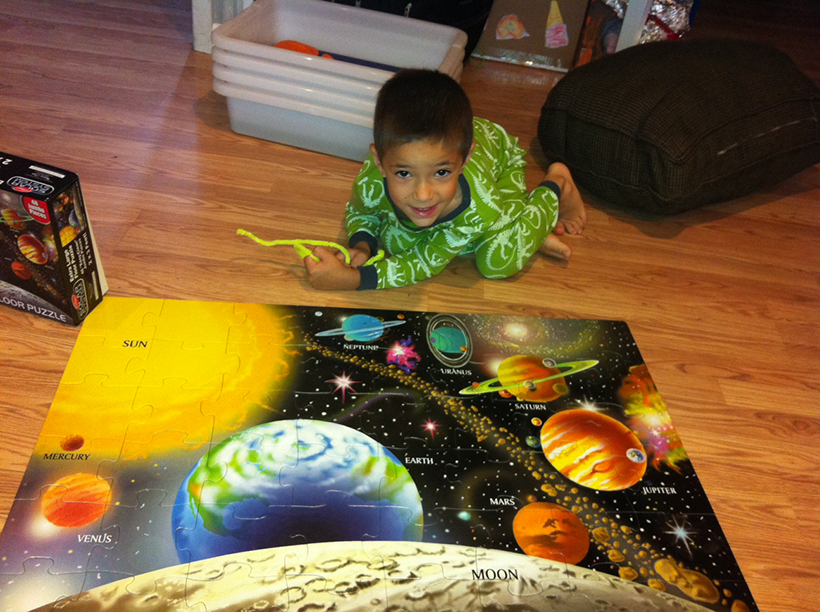 boy and puzzle Two Simple Solar System