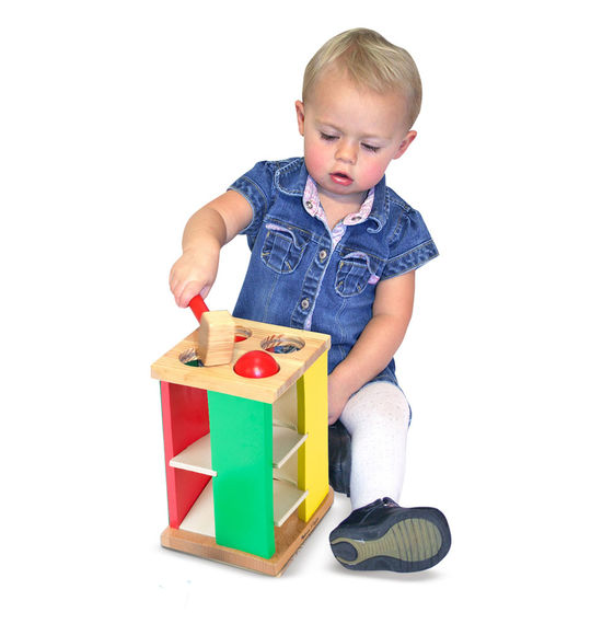 We've taken the classic pounding toy to new heights! Knock the four brightly colored balls through the holes, then watch and listen as they roll down the ramps. Sturdy wooden hammer included.
