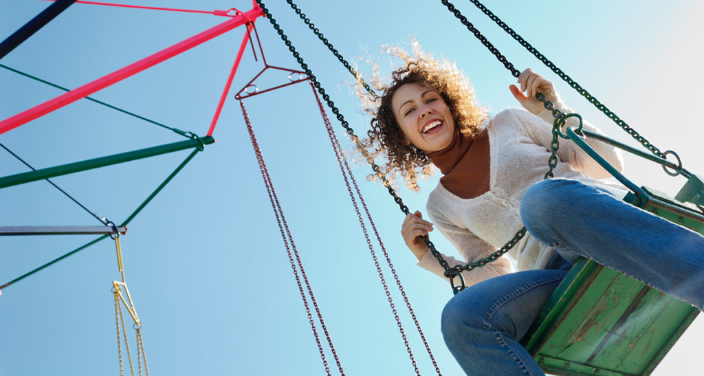 woman being free on a swing