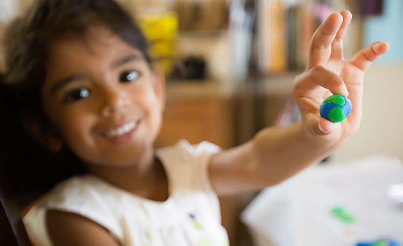 Little girl making a clay model of the Earth; Shutterstock ID 511525543; Purchase Order: -